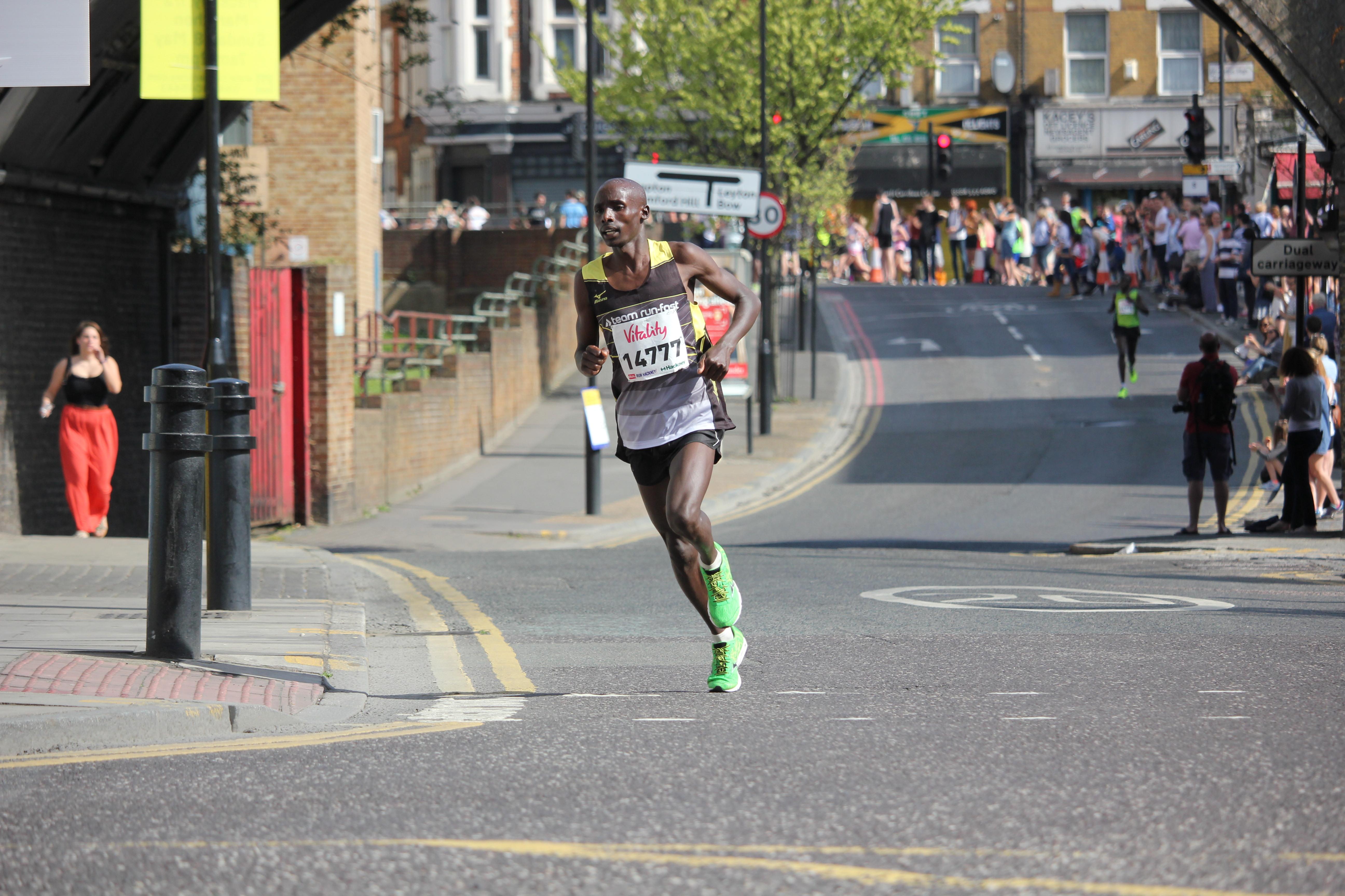Mark Kibiwott leads the men's race in Hackney