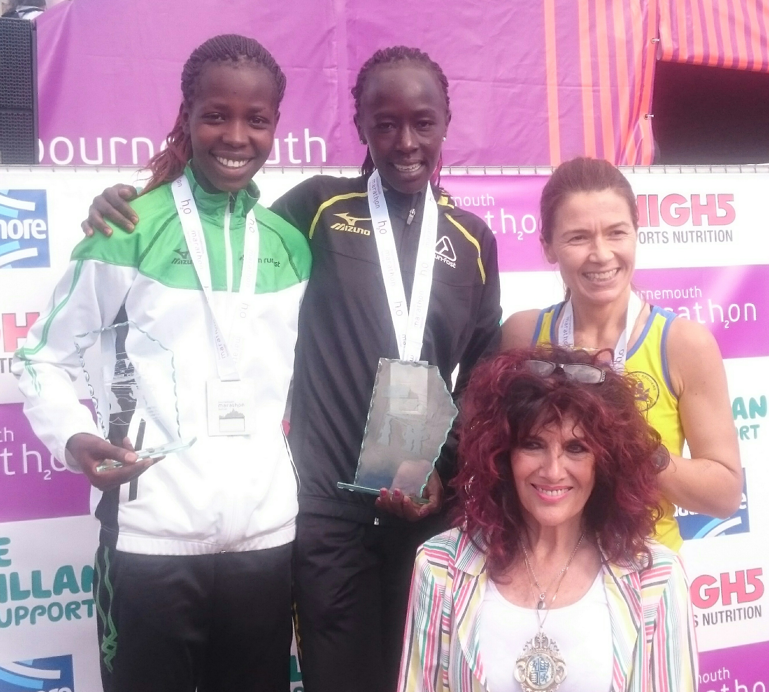 Eddah & Hildah on the Bournemouth Marathon podium with 3rd place Emma Prideaux of Billericay